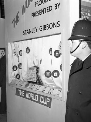 A police officer stands next to the display case in the Central Hall, Westminster, from which the World Cup was stolen (PA)