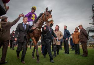 CHELTENHAM, ENGLAND - MARCH 11:  Racegoers congratulate Windsor Park ridden by Davy Russell after he won the first race on the second day of the Cheltenham Festival on March 11, 2015 in Cheltenham, England. Thousands of racing enthusiasts are expected at the four-day festival which opened yesterday.  (Photo by Matt Cardy/Getty Images)