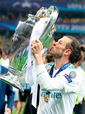 Real Madrid's Gareth Bale celebrates with the trophy after winning the UEFA Champions League Final at the NSK Olimpiyskiy Stadium, Kiev. Nick Potts/PA Wire