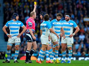 Off you go: Argentina's lock Tomas Lavanini (centre) receives a controversial yellow card from referee Wayne Barnes