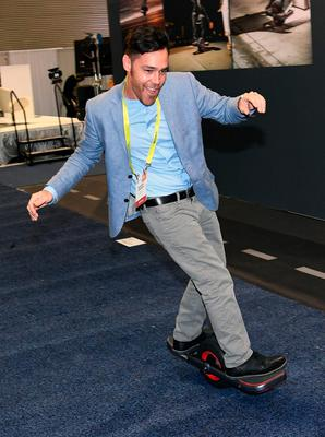 LAS VEGAS, NV - JANUARY 05:  Brandon Yamawaki demonstrates the Jyro Roll at CES 2017 at the Sands Expo and Convention Center on January 5, 2017 in Las Vegas, Nevada. The USD 1,299, self-balancing single-wheel skateboard will be available in the Fall of 2017. CES, the world's largest annual consumer technology trade show, runs through January 8 and features 3,800 exhibitors showing off their latest products and services to more than 165,000 attendees.  (Photo by Ethan Miller/Getty Images)