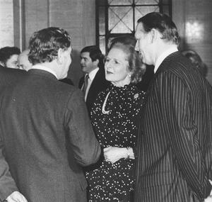 Margaret Thatcher, former British Prime Minister, on a visit to Belfast. 1981. Mrs Thatcher talks to guests during a dinner held at Stormont.  5/3/1981