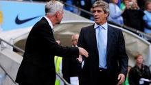 MANCHESTER, ENGLAND - AUGUST 19:  (L to R) Alan Pardew the Newcastle United manager and Manuel Pellegrini the Manchester City manager shake hands prior to kickoff the Barclays Premier League match between Manchester City and Newcastle United at the Etihad Stadium on August 19, 2013 in Manchester, England.  (Photo by Michael Regan/Getty Images)
