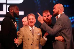 Deontay Wilder and Tyson Fury discuss a spar during a pre-fight press conference.