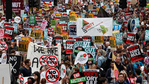 Demonstrators with placards crowd the area around the Bank of England as they gather for the start of a protest against the British government's spending cuts and austerity measures in London on June 20, 2015. AFP/Getty Images