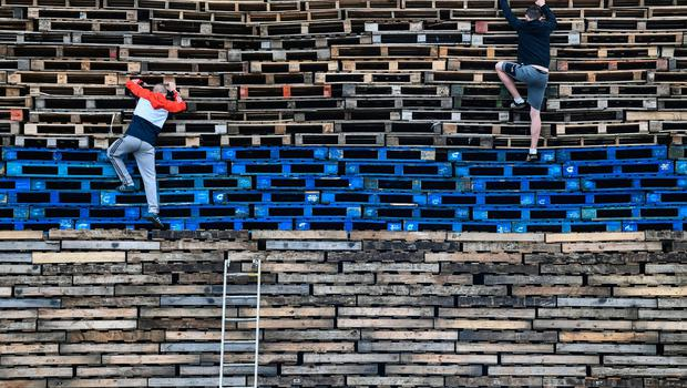 BELFAST, NORTHERN IRELAND - JULY 10:  Loyalists climb The Village bonfire being built in preparation for the 11th night bonfire on July 10, 2017 in Belfast.  (Photo by Jeff J Mitchell/Getty Images)