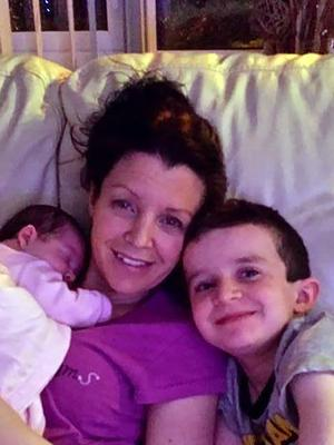 Louise McGrotty with baby Rioghnach-Ann, who survived the tragedy, and son Evan (8), who lost his life
