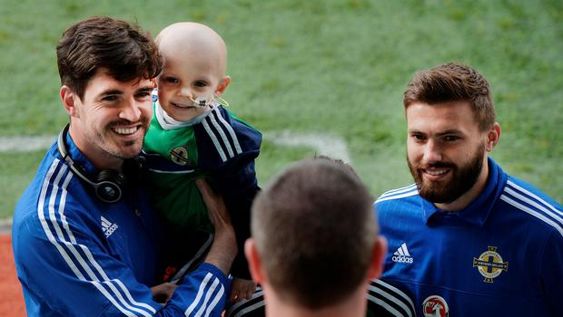 Kyle Lafferty and Stuart Dallas pose with fans before the international friendly game between Northern Ireland and Belarus on May 26, 2016 in Belfast, Northern Ireland. (Photo by Charles McQuillan/Getty Images)