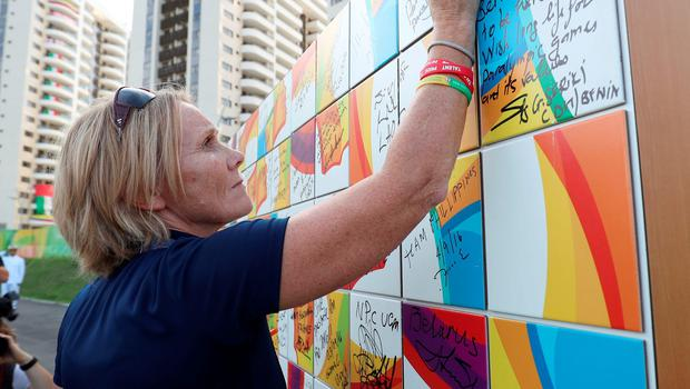 ParalympicsGB Chef de Mission Penny Briscoe writes a message on a wall during the Paralympics GB Welcome Ceremony at the Athletes Village ahead of the 2016 Rio Paralympic Games, Brazil. PRESS ASSOCIATION Photo. Picture date: Sunday September 4, 2016. Photo credit should read: Andrew Matthews/PA Wire. EDITORIAL USE ONLY