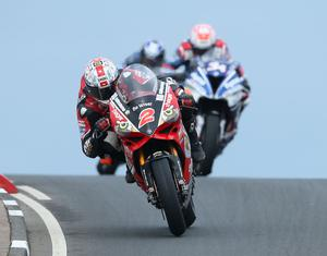Glenn Irwin leads Ian Hutchinson and  Alastair Seeley over Black Hill during Saturday's Vauxhall NW 200 Superbike Race  at the Vauxhall International 2017 North West 200 around the  8.9 mile Triangle course. Picture by Brian Little/PressEye