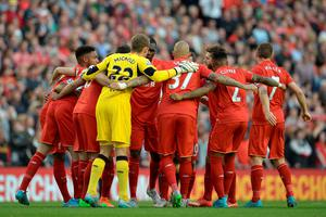 The Liverpool team form a huddle before the start of the English Premier League football match between Liverpool and Bournemouth at the Anfield stadium in Liverpool, north-west England on August 17, 2015. AFP PHOTO / OLI SCARFF  RESTRICTED TO EDITORIAL USE. No use with unauthorized audio, video, data, fixture lists, club/league logos or 'live' services. Online in-match use limited to 75 images, no video emulation. No use in betting, games or single club/league/player publications.OLI SCARFF/AFP/Getty Images