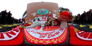LIVERPOOL, ENGLAND - APRIL 15: (EDITOR'S NOTE: Image was created as an Equirectangular Panorama. Import image into a panoramic player to create an interactive 360 degree view.) People arrive for a memorial service to mark the 27th anniversary of the Hillsborough disaster, at Anfield stadium on April 15, 2016 in Liverpool, England. Thousands of fans, friends and relatives took part in the final Anfield memorial service for the 96 victims of the Hillsborough disaster. Earlier this year relatives of the victims agreed that this year's service would be the last. Bells across the City of Liverpool rung during a one minute silence in memory of the 96 Liverpool supporters who lost their lives during a crush at an FA Cup semi-final match against Nottingham Forest at the Hillsborough football ground in Sheffield, South Yorkshire in 1989.  (Photo by Christopher Furlong/Getty Images)