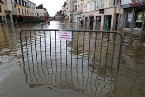A fence bearing a sign reading ' closed street, flood' is pictured in a flooded street on June 1, 2016 in Paris. Torrential downpours have lashed parts of northern Europe in recent days, leaving four dead in Germany, breaching the banks of the Seine in Paris and flooding rural roads and villages.KENZO TRIBOUILLARD/AFP/Getty Images