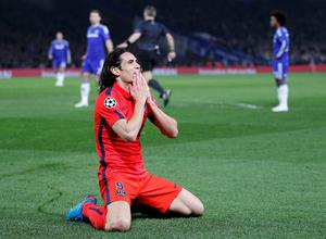 Paris Saint-Germain's Uruguayan forward Edinson Cavani gestures after a failing to score during the UEFA Champions League round of 16 second leg football match between Chelsea and Paris Saint-Germain at Stamford Bridge in London on March 11, 2015.  AFP PHOTO / IAN KINGTONIAN KINGTON/AFP/Getty Images