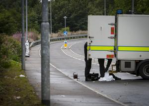 A police photographer takes photographs of the suspect device during a security alert at Southway, Derry. Southway is an arterial route into the Creggan Estate in the city. The area was still sealed off at 4.30pm.