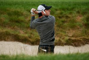 ARDMORE, PA - JUNE 14:  Rory McIlroy of Northern Ireland hits from a bunker on the 15th hole during a continuation of Round One of the 113th U.S. Open at Merion Golf Club on June 14, 2013 in Ardmore, Pennsylvania.  (Photo by Andrew Redington/Getty Images)