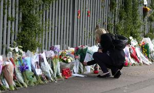 Tributes for Ann Maguire outside Corpus Christi school (Lynne Cameron/PA)