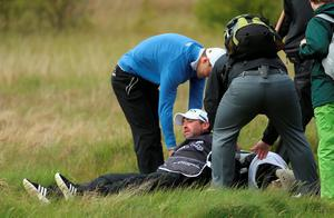 NEWCASTLE, NORTHERN IRELAND - MAY 29:  Martin Kaymer of Germany helps his caddie Craig Connelly to his feet after he fell during the Second Round of the Dubai Duty Free Irish Open Hosted by the Rory Foundation at Royal County Down Golf Club on May 29, 2015 in Newcastle, Northern Ireland.  (Photo by Andrew Redington/Getty Images)