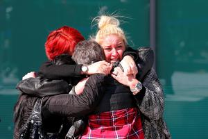 WARRINGTON, ENGLAND - APRIL 26: Relatives of Hillsborough victims hug as they depart Birchwood Park after hearing the conclusions of the Hillsborough inquest on April 26, 2016 in Warrington, England. The fresh inquests into the 1989 Hillsborough disaster, in which 96 football supporters were crushed to death, concluded on April 26, 2016 with a verdict of unlawful killing, after the initial verdicts were quashed. Relatives of Liverpool supporters who died in Britain's worst sporting disaster gathered in the purpose-built court to hear the jury's verdict in Warrington after a 25 year fight to overturn the accidental death verdicts handed down at the initial 1991 inquiry.  (Photo by Dave Thompson/Getty Images)