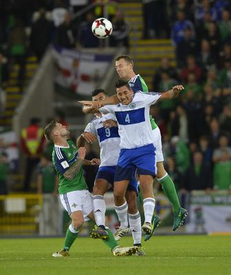 PACEMAKER BELFAST   08/10/2016 Northern Ireland v San Marino World Cup Qualifier Group C Northern Ireland's Jonny Evans and San Marino's Matteo Coppini during this evenings game at the National Stadium in Belfast. Photo Mark Marlow/Pacemaker Press