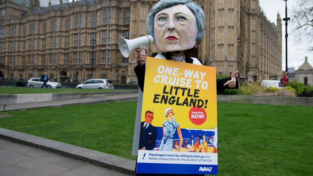 A giant headed Theresa May in Parliament Square, London during a protest by Avaaz after PM signed a letter to trigger Article 50  that starts the formal exit process by the UK from the European Union. PRESS ASSOCIATION Photo. Picture date: Wednesday March 29, 2017. Photo credit should read: David Mirzoeff/PA Wire