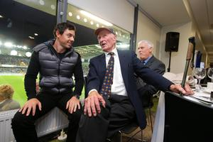 Press Eye - Belfast - Northern Ireland - 8th October 2016 -   The National Football Stadium at Windsor Park Opening Game and Ceremony  Northern Ireland vs San Marino 2018 FIFA World Cup Qualifier  Golfer Rory McIlroy shares a joke with NI Football legend Harry Gregg pictured at the National Football Stadium  Photo by Kelvin Boyes / Press Eye