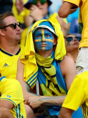 SAMARA, RUSSIA - JULY 07:  Sweden fans look dejected following the 2018 FIFA World Cup Russia Quarter Final match between Sweden and England at Samara Arena on July 7, 2018 in Samara, Russia.  (Photo by Ryan Pierse/Getty Images)