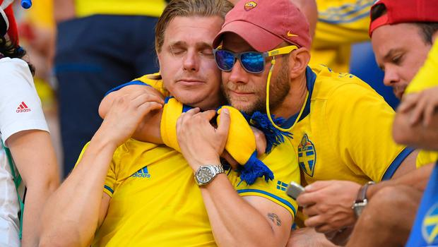 SAMARA, RUSSIA - JULY 07:  Sweden fans look dejected following the 2018 FIFA World Cup Russia Quarter Final match between Sweden and England at Samara Arena on July 7, 2018 in Samara, Russia.  (Photo by Matthias Hangst/Getty Images)