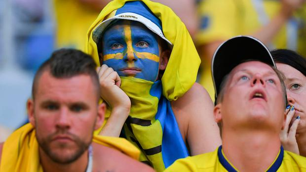 Sweden fans react at the end of the Russia 2018 World Cup quarter-final football match between Sweden and England at the Samara Arena in Samara on July 7, 2018. / AFP PHOTO / Manan VATSYAYANA / RESTRICTED TO EDITORIAL USE - NO MOBILE PUSH ALERTS/DOWNLOADS MANAN VATSYAYANA/AFP/Getty Images