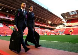 Liverpool's Alberto Moreno (left) and Roberto Firmino arrive for the Barclays Premier League match at Anfield, Liverpool. PA