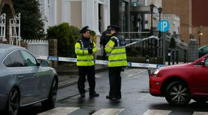 Gardai outside the Regency Hotel in Dublin after one man died and two others were injured following a shooting incident at the hotel. PA