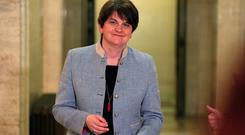 DUP leader Arlene Foster speaks to the media in the Great Hall of Parliament Buildings, Stormont. Credit: Brian Lawless/PA Wire