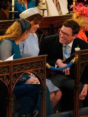 WINDSOR, UNITED KINGDOM - MAY 19: (L-R) Princess Beatrice (left), Princess Eugenie and Jack Brooksbank take their seats at St George's Chapel at Windsor Castle before the wedding of Prince Harry to Meghan Markle on May 19, 2018 in Windsor, England. (Photo by  Jonathan Brady - WPA Pool/Getty Images)