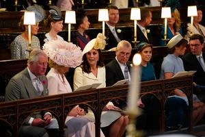 WINDSOR, UNITED KINGDOM - MAY 19: (L-R) Prince Charles, Prince of Wales, Camilla, Duchess of Cornwall, Catherine, Duchess of Cambridge, Prince Andrew, Duke of York, Princess Beatrice, Princess Eugenie and Jack Brooksbank take their seats at St George's Chapel at Windsor Castle before the wedding of Prince Harry to Meghan Markle on May 19, 2018 in Windsor, England. (Photo by  Jonathan Brady - WPA Pool/Getty Images)