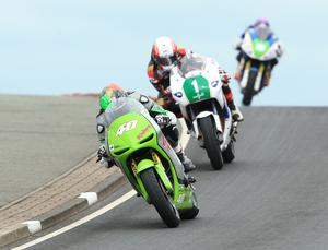 Martin Jessopp (Riders Motorcycles Kawasaki) ahead of Michael Rutter (KMR Kawasaki) and Daniel Cooper (D Cooper Motorsport/KW Electrical Kawasaki) during the Supertwins race at the North West 200 in Co Londonderry.  Photo by David Maginnis/Pacemaker Press