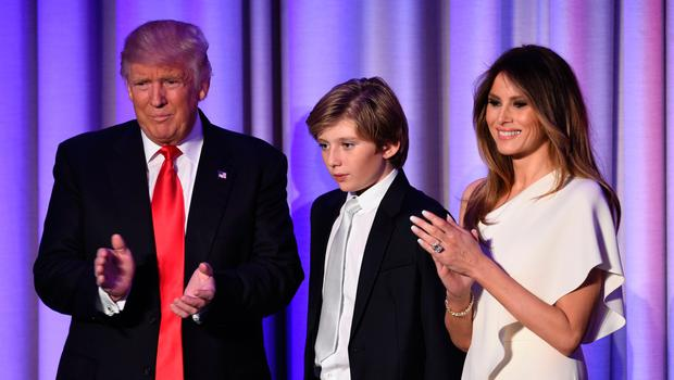 US President-elect Donald Trump arrives with his son Baron and wife Melania at the New York Hilton Midtown in New York on November 8, 2016. AFP/Getty Images
