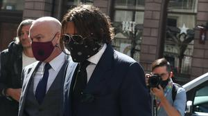 Actor Johnny Depp (centre) arrives at the High Court in London (Steve Parsons/PA)