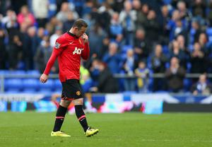 LIVERPOOL, ENGLAND - APRIL 20:  A dejected Wayne Rooney of Manchester United after defeat during the Barclays Premier League match between Everton and Manchester United at Goodison Park on April 20, 2014 in Liverpool, England.  (Photo by Clive Brunskill/Getty Images)