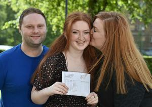 Pacemaker Press 20-08-2020:  Student Aoife Marie Diamond pictured with Donna and Aidan Williamson celebrating her GCSE success at St Dominic's Grammar School Belfast .There has been a significant rise in the number of top GCSE grades in Northern Ireland. Grades A*-A were awarded to 37.1% of entries, up from just under a third of entries in 2019. Picture By: Arthur Allison/ Pacemaker Press.
