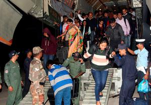 "This handout photo released on April 27, 2015 by the Indian Ministry of Defence shows evacuated people from earthquake-hit Nepal deboarding an Indian Air Force (IAF) aircraft at Air Force Station Palam in New Delhi on April 26. Nepalis started fleeing their devastated capital on April 27 after an earthquake killed more than 3,800 people and toppled entire streets, as the United Nations prepared a ""massive"" aid operation.  AFP PHOTO / MOD   ----EDITORS NOTE---- RESTRICTED TO EDITORIAL USE - MANDATORY CREDIT  - ""AFP PHOTO / MOD "" - NO MARKETING NO ADVERTISING CAMPAIGNS - DISTRIBUTED AS A SERVICE TO CLIENTS------MOD/AFP/Getty Images"