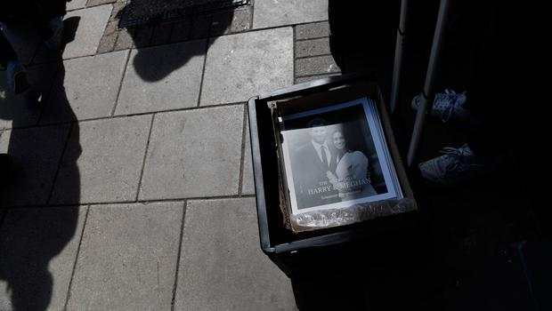Pictures of Britain's Prince Harry and US actress Meghan Markle are seen in a box on a pavement in Windsor on May 18, 2018, the day before the Royal wedding.  Britain's Prince Harry and US actress Meghan Markle will marry on May 19 at St George's Chapel in Windsor Castle. / AFP PHOTO / Paul ELLISPAUL ELLIS/AFP/Getty Images