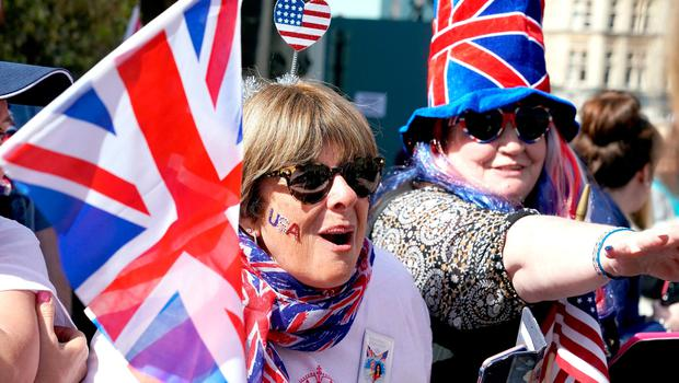 Royal fans in Windsor ahead of the wedding of Prince Harry and Meghan Markle on Saturday. PRESS ASSOCIATION Photo. Picture date: Friday May 18, 2018. See PA story ROYAL Wedding. Photo credit should read: Owen Humphreys/PA Wire