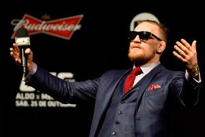 Conor McGregor wears a three-piece suit to a fans Q&A before the UFC 179 weigh-in at Maracanazinho on October 24, 2014 in Rio de Janeiro, Brazil.  (Photo by Buda Mendes/Getty Images)