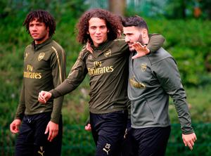 Making plans: Arsenal's Matteo Guendouzi (centre) and Sead Kolasinac during yesterday's training session at London Colney