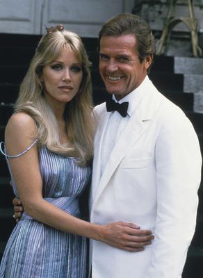 Roger Moore, right, poses with his co-star Tanya Roberts (Alexis Duclos/AP)