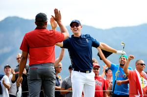 Get in: Justin Rose celebrates his hole-in-one at the fourth