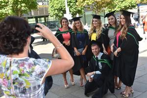 Ulster University Graduations-Waterfront Hall 03-07-15 Posing for that special graduation photo. Photo by Simon Graham/Harrison Photography