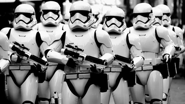 """HOLLYWOOD, CA - DECEMBER 14:  (Editors Note: Image altered using digital filters) Stormtrooers arrive at The Premiere of Walt Disney Pictures and Lucasfilm's """"Star Wars: The Force Awakens"""" on December 14, 2015 in Hollywood, California.  (Photo by Frazer Harrison/Getty Images)"""