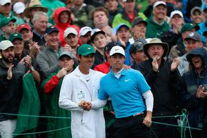 Rory McIlroy and caddie Harry Diamond shake hands on the 18th green at Augusta.