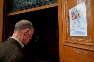 A member of the public arrives to sign a book of condolence at the Pro-Cathedral in Dublin's city centre for those killed in the Berkeley balcony collapse. PRESS ASSOCIATION Photo. Picture date: Saturday June 20, 2015. Photo credit should read: Brian Lawless/PA Wire